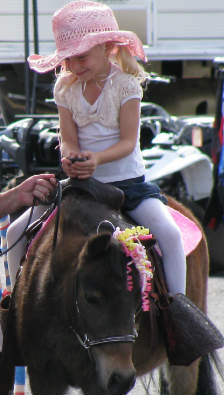 pink girl on horse